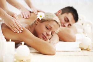 Beautiful couple enjoying in the back massage.