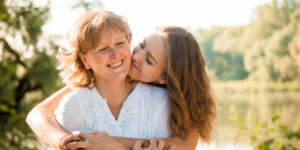 Mature Mother Hugging With Her Daughter