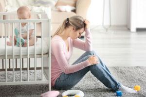 Mother on Floor Dealing With Postnatal Depression