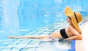 Pregnant Woman Relaxing In Pool