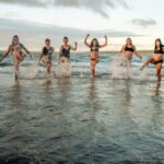 Photoshoot of pregnant women's playing in Beach